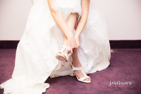 bride dressing wedding shoes