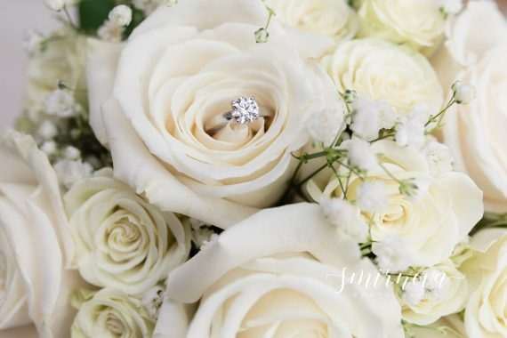 engagement ring in wedding bouquet