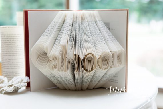book pages carved word